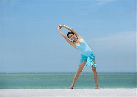 Woman stretching on beach Stock Photo - Premium Royalty-Free, Code: 695-05763448