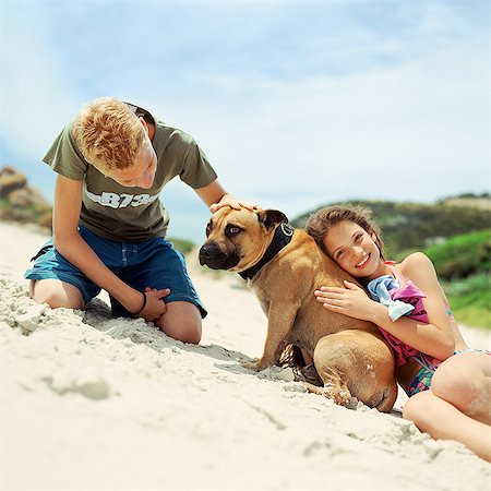 Children with dog on the beach Stock Photo - Premium Royalty-Free, Code: 695-05774083