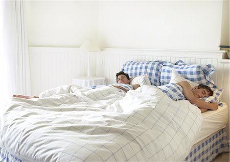 Two teenage boys sleeping in bed Stock Photo - Premium Royalty-Free, Code: 695-05774186