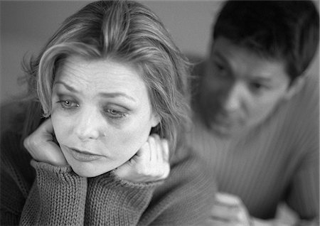 sad lovers break up - Man standing behind tearful woman, close-up, b&w Stock Photo - Premium Royalty-Free, Code: 695-05774575