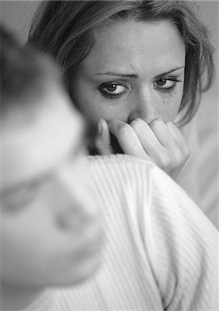 sad lovers break up - Tearful woman with hand against mouth, looking at man, close-up, b&w Stock Photo - Premium Royalty-Free, Code: 695-05774584