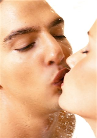 Couple kissing through wet shower door, close-up Stock Photo - Premium Royalty-Free, Code: 695-05775969