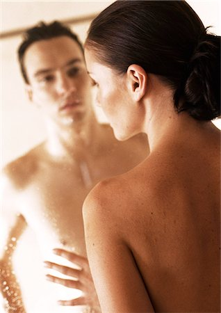 Nude couple facing each other through glass shower door, close-up Stock Photo - Premium Royalty-Free, Code: 695-05775976