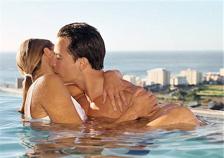 Couple kissing in swimming pool Stock Photo - Premium Royalty-Free, Code: 695-05775989