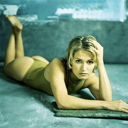 Woman lying on stomach, portrait Stock Photo - Premium Royalty-Free, Code: 695-05776032