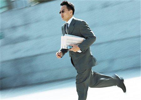 sweaty businessman - Businessman running outdoors Stock Photo - Premium Royalty-Free, Code: 695-05776316