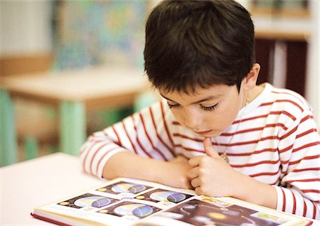 students learning cartoon - Child reading, close-up Stock Photo - Premium Royalty-Free, Code: 695-05776434