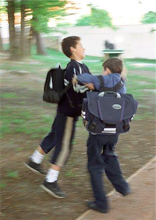 student fighting - Children playfighting, full length, blurred motion Stock Photo - Premium Royalty-Free, Code: 695-05776466