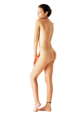 Nude woman looking over shoulder, side view Stock Photo - Premium Royalty-Free, Code: 695-05777146