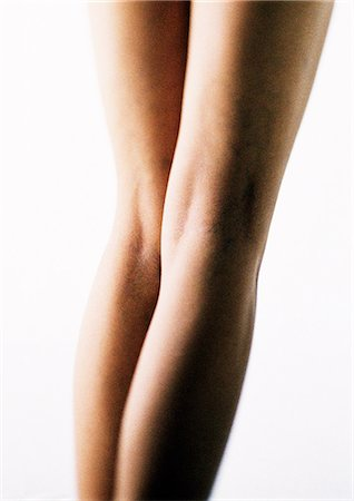 Woman's bare legs, rear view, close-up Stock Photo - Premium Royalty-Free, Code: 695-05777160