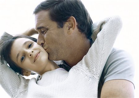 preteen kissing - Girl reaching arms back around father's neck, father kissing girl's cheek Stock Photo - Premium Royalty-Free, Code: 695-05777400