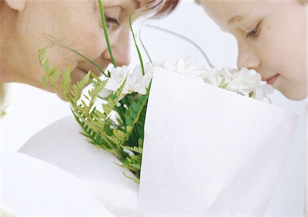 Grandmother and grandson smelling bouquet of flowers Stock Photo - Premium Royalty-Free, Code: 695-05777489