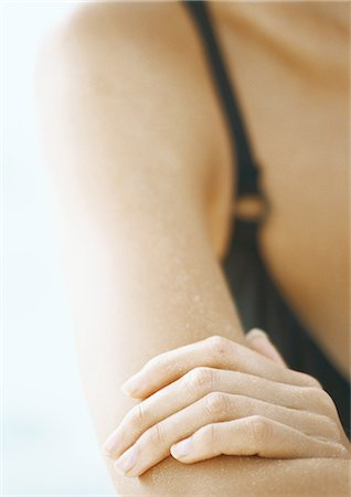 Woman's hand on her arm, close-up Stock Photo - Premium Royalty-Free, Code: 695-05777900
