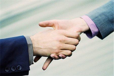 release - Hesitant handshake between professionals Stock Photo - Premium Royalty-Free, Code: 695-05770033