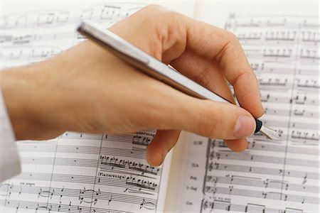 scoring - Composer editing musical score Stock Photo - Premium Royalty-Free, Code: 695-05770413