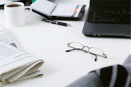 selective focus computer no people - Glasses left on messy desk Stock Photo - Premium Royalty-Free, Code: 695-05770550