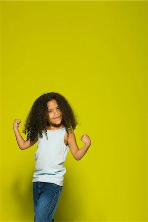 Little girl flexing muscles, portrait Stock Photo - Premium Royalty-Free, Code: 695-05770694