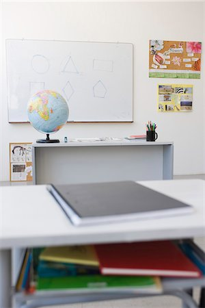 school desk - Classroom, school desk full of books and notebooks Stock Photo - Premium Royalty-Free, Code: 695-05770715