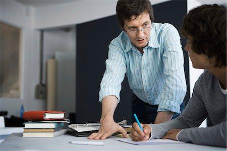 Teacher explaining assignment to student Stock Photo - Premium Royalty-Free, Code: 695-05770808