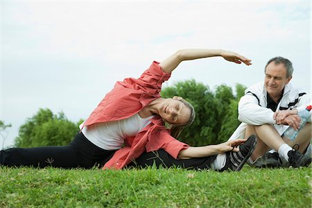Mature couple stretching in park Stock Photo - Premium Royalty-Free, Code: 695-05771577