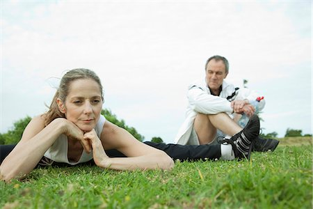 Mature couple stretching in park Stock Photo - Premium Royalty-Free, Code: 695-05771579