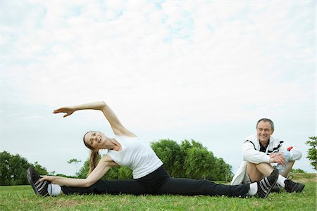Mature couple stretching in park Stock Photo - Premium Royalty-Free, Code: 695-05771580