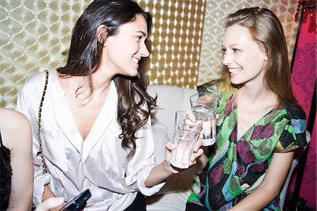 Friends chatting together at nightclub Stock Photo - Premium Royalty-Free, Code: 695-05771594