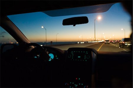 Driving at dusk Stock Photo - Premium Royalty-Free, Code: 695-05771625