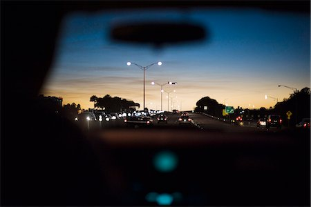 Driving at dusk Stock Photo - Premium Royalty-Free, Code: 695-05771629