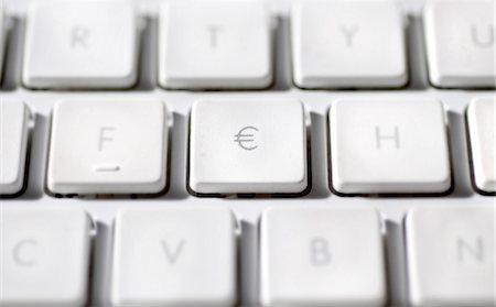 Euro sign on laptop computer keyboard Stock Photo - Premium Royalty-Free, Code: 695-05771643
