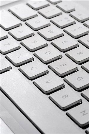 Laptop computer keyboard, close-up Stock Photo - Premium Royalty-Free, Code: 695-05771658