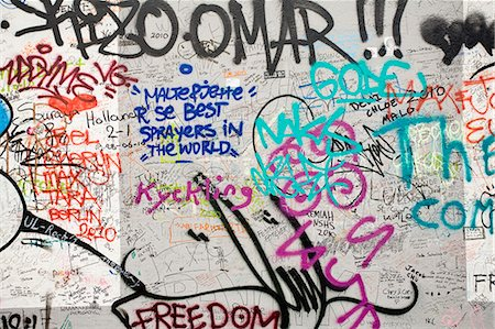 painted - Graffiti covering a section of the Berlin Wall, Berlin, Germany Stock Photo - Premium Royalty-Free, Code: 695-05771783
