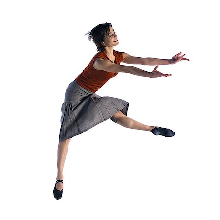 female white background full body - Woman jumping Stock Photo - Premium Royalty-Free, Code: 695-05772624