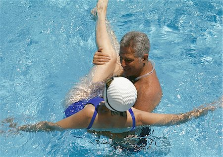 seniors and swim cap - Mature couple in pool Stock Photo - Premium Royalty-Free, Code: 695-05772694