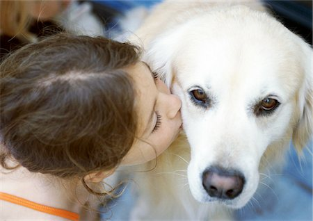 dog kissing girl - Girl kissing dog, elevated view Stock Photo - Premium Royalty-Free, Code: 695-05773933