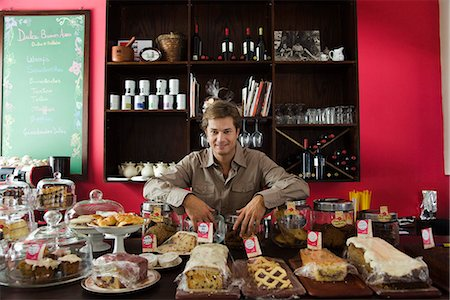 people in argentina - Cafe owner, assorted pastries and baked goods on counter Stock Photo - Premium Royalty-Free, Code: 695-05780151