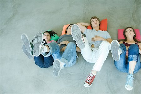 female 16 year old feet - Four teen friends lying on backs on floor, holding up legs, focus on soles of shoes Stock Photo - Premium Royalty-Free, Code: 695-03375665