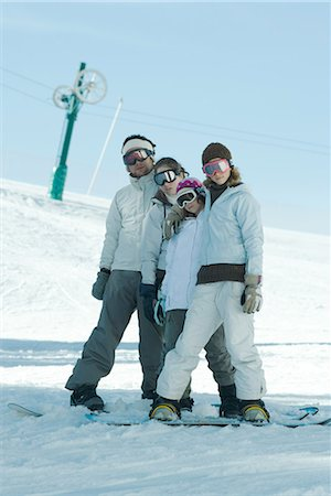 Group of snowboarders posing in snow, full length Stock Photo - Premium Royalty-Free, Code: 695-03376167