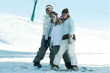 Group of snowboarders posing in snow, full length Stock Photo - Premium Royalty-Free, Code: 695-03376168