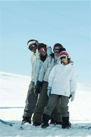Group of snowboarders posing in snow, full length Stock Photo - Premium Royalty-Free, Code: 695-03376162