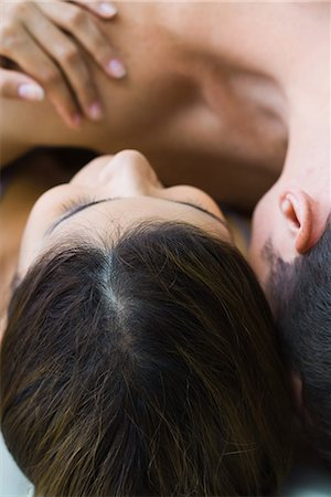 Man lying on top of woman, cropped view, close-up Stock Photo - Premium Royalty-Free, Code: 695-03377011