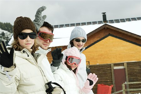 Group of young skiers waving at camera Stock Photo - Premium Royalty-Free, Code: 695-03377334