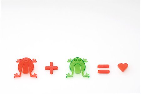 Green frog plus red frog equals love Stock Photo - Premium Royalty-Free, Code: 695-03379064