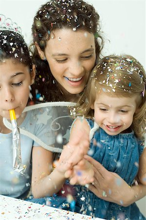 family image and confetti - Young woman and two little girls throwing confetti, all smiling Stock Photo - Premium Royalty-Free, Code: 695-03379655
