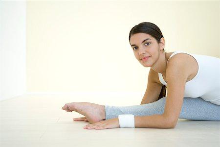 feet gymnast - Woman doing split, smiling at camera Stock Photo - Premium Royalty-Free, Code: 695-03379949