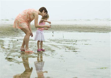 Mother and daughter on beach, full length Stock Photo - Premium Royalty-Free, Code: 695-03373517
