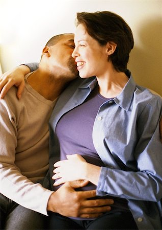 Pregnant woman sitting with arm around man, portrait Stock Photo - Premium Royalty-Free, Code: 695-03384040