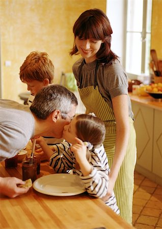 daughter kissing mother - Family in kitchen, child kissing father on cheek Stock Photo - Premium Royalty-Free, Code: 695-03384578