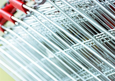 empty shopping cart - Shopping carts, extreme close-up Stock Photo - Premium Royalty-Free, Code: 695-03385297