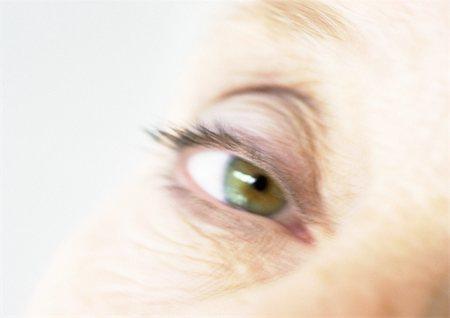 Senior woman's eye, close-up, blurred Stock Photo - Premium Royalty-Free, Code: 695-03385852
